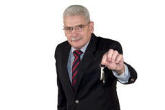 A caucasian senior manager offering a key Royalty Free Stock Photo