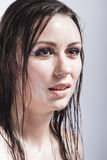 Caucasian Sensual Brunette Girl Showing Wet and Shining Skin and Wet Hair Stock Photography