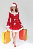 Caucasian 'sexy' de sorriso Ginger Santa Helper Girl com abundância de C Fotos de Stock