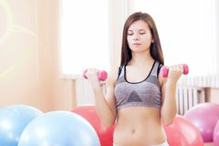 Caucasian Sexy Female Athlete Posing With Barbells Stock Photography