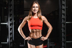 Caucasian fitness female model in gym close up abs royalty free stock images