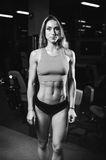 Caucasian fitness female model in gym close up abs royalty free stock photos