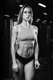Caucasian fitness female model in gym close up abs royalty free stock photography