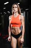 Caucasian fitness female model in gym close up abs. Pretty caucasian fitness female model in gym close up abs concept man on diet shirtless training six pack royalty free stock photography