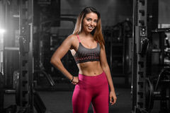 Caucasian fitness female model in gym close up abs. Pretty caucasian fitness female model in gym close up abs concept man on diet shirtless training six pack stock photo