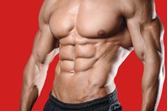 Caucasian fitness model in gym close up abs. Handsome caucasian fitness model in gym close up abs concept man on diet shirtless training six pack healthcare royalty free stock photography