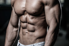 Caucasian fitness model in gym close up abs royalty free stock photography