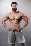 Caucasian fitness model in gym close up abs stock images