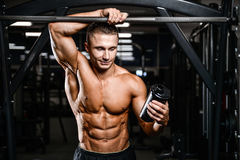 Caucasian fitness model in gym close up abs. Handsome caucasian fitness model in gym close up abs concept man on diet shirtless training six pack healthcare stock photo