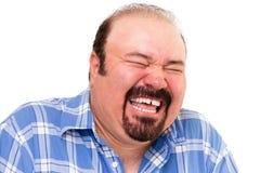 Caucasian skäggig lycklig man som högt skrattar Royaltyfri Fotografi