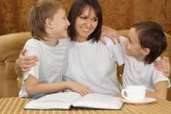 A Caucasian smile mother with two brothers Stock Photography