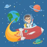 Caucasian smiling boy riding a spaceship. Little caucasian happy smiling boy wearing space suit and riding a spaceship. Cheerful boy in space helmet traveling Royalty Free Stock Photo