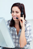 Caucasian smiling businesswoman with headset on Royalty Free Stock Photo