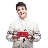 Caucasian smiling casual young man holding gift Royalty Free Stock Image