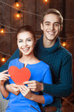 Caucasian smiling couple. Happy couple holding red heart Stock Photos