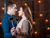 Caucasian smiling couple. Happy couple holding red heart, heart focus Royalty Free Stock Photos