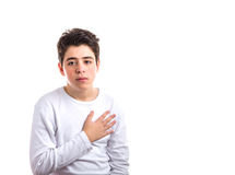 Caucasian smooth-skinned boy keeping his right hand on the heart Stock Photo