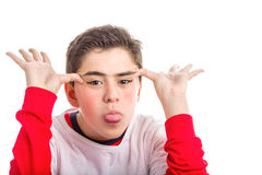 Caucasian smooth-skinned boy making faces with both hands Stock Photography