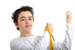 Caucasian smooth-skinned boy measuring muscle with meter tape Stock Photo