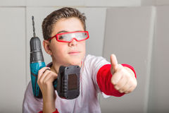 Caucasian smooth-skinned boy wearing red goggles and holding a c Royalty Free Stock Photo