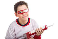 Caucasian smooth-skinned boy wearing red goggles and holding a c Stock Images