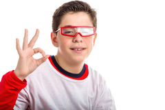 Caucasian smooth-skinned boy wearing red goggles makes OK sign. Caucasian smooth-skinned boy wearing red googles smiles while he makes OK, all right, sign with Stock Images