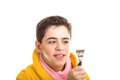 Caucasian smooth-skinned boy in yellow bathrobe and pink towel s Stock Photos