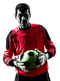 Caucasian soccer player goalkeeper man  holding ball silhouette Stock Image