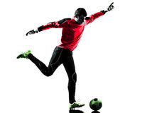Caucasian soccer player goalkeeper man kicking ball silhouette Royalty Free Stock Photos