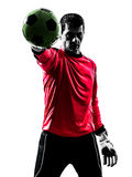 Caucasian soccer player goalkeeper man  stopping ball one hand s. One caucasian soccer player goalkeeper man standing stopping ball with one hand in silhouette Royalty Free Stock Photography
