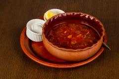 Caucasian Solyanka soup. With cream and lemon Stock Image