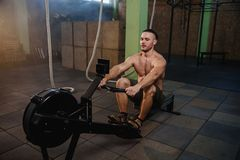 Caucasian sport man during training in the gym. stock images