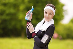 Caucasian Sportive Woman Drinking Water During Her Regular Joggo Stock Photos
