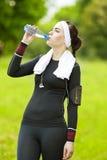 Caucasian Sportive Woman Drinking Water During Her Regular Joggo Stock Photography