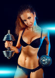 Caucasian sports female in black lingeris with dumbbells Royalty Free Stock Photography