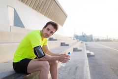 Caucasian sports man holding bottle of water and look at you with copy space area for your text message Royalty Free Stock Photos