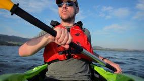 Caucasian Sportsman Kayak Tour on the Lake. Kayaking Theme.