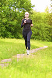 Caucasian Sportwoman Having Her Regular Training Outdoors Royalty Free Stock Photos