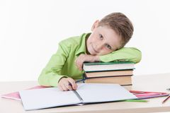 Caucasian student boy doing homework. Stock Image