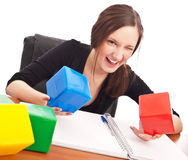 Caucasian student playing cubes Stock Photography