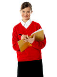 Caucasian student school girl writing on her noteb Royalty Free Stock Photo