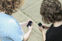 Caucasian student smartphone Stock Photography