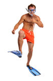 Caucasian swimmer in mask, snorkel, and flippers. Caucasian swimmer wearing mask, snorkel, and flippers walking Stock Images