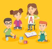 Caucasian teacher teaching children the alphabet. Stock Images