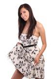 Caucasian Teen Girl in dress holding up hem Royalty Free Stock Image