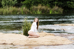 Caucasian Teen Woman Sitting On Dirt In River White Leotard Stock Images