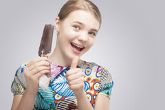 Caucasian Teenage Girl With Chocolate Melting  Ice-Cream. Pretty Caucasian Teenage Girl With Chocolate Melting  Ice-Cream Showing Thumbs-Up Sign. Horizontal Royalty Free Stock Photo