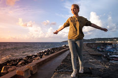 Caucasian teenage girl relaxing on a seacoast Stock Photo