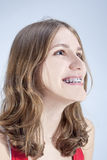 Caucasian Teenage Girl Showing Her Teeth Brackets. Posing Indoor Royalty Free Stock Photo