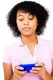 Caucasian teenage girl text messaging Stock Photo